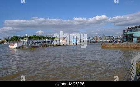 GREENWICH, LONDON, UK - AUGUST 10TH, 2017: Greenwich Pier with river boats and people. - Stock Photo