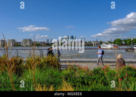 GREENWICH, LONDON, UK - AUGUST 10TH, 2017: Canary Wharf and River Thames with colourful flower beds in the foreground. - Stock Photo