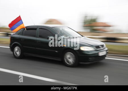 YEREVAN, ARMENIA - APRIL 27, 2018: A car with an Armenian national flag during a car rally, organised by the opposition led by Nikol Pashinyan, from Yerevan to the city of Gyumri where an opposition rally is to take place; in April 2018, the opposition staged mass protests in capital Yerevan which led to the resignation of prime minister Sargsyan; opposition leaders have announced plans to continue protests as the National Assembly of Armenia prepares to elect a new prime minister on May 1, 2018. Artyom Geodakyan/TASS - Stock Photo