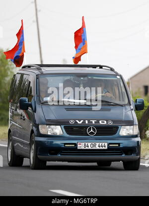 YEREVAN, ARMENIA - APRIL 27, 2018: A car with Armenian national flags during a car rally, organised by the opposition led by Nikol Pashinyan, from Yerevan to the city of Gyumri where an opposition rally is to take place; in April 2018, the opposition staged mass protests in capital Yerevan which led to the resignation of prime minister Sargsyan; opposition leaders have announced plans to continue protests as the National Assembly of Armenia prepares to elect a new prime minister on May 1, 2018. Artyom Geodakyan/TASS - Stock Photo
