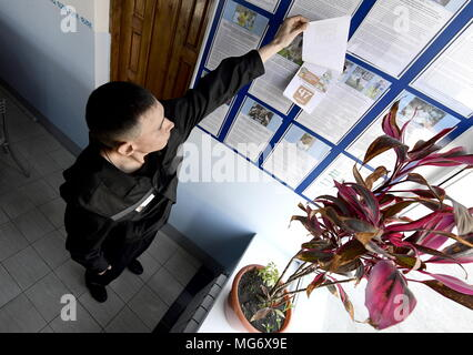 Russia. 27th Apr, 2018. PRIMORYE TERRITORY, RUSSIA - APRIL 27, 2018: A convict turns over a page of a calendar showing countdown till the beginning of the 2018 FIFA World Cup in Russia, at penal colony No 27 in the village of Volchanets. Yuri Smityuk/TASS Credit: ITAR-TASS News Agency/Alamy Live News - Stock Photo