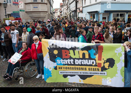 27 April 2018, Germany, Witzenhausen: Participants of a street festival from the work group 'aslyum' at the market square with a banner stating 'bunt statt braun' (lit. colourful instead of brown). An escalated police deployment at a protest against the deportation of a Syrian now has legal consequences and will face investigations from the public prosecutor's office. Photo: Swen Pförtner/dpa - Stock Photo