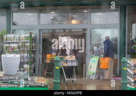 Stockton Heath village. 17th Apr, 2018. UK Weather: Stockton Heath in Cheshire, England, received a downpour of rain this afternoon, 27 April 2018 and was captured through the water covered windows of a car Credit: John Hopkins/Alamy Live News - Stock Photo