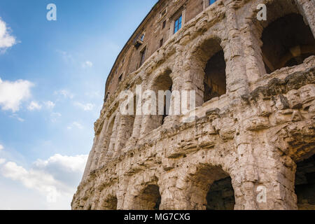 Scenic view on the ancient Theatre of Marcellus (Teatro di Marcello) and ruin of old building (antique columns and detail of the cornice) next to it o - Stock Photo