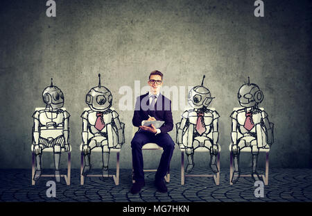 Human vs Robots concept. Business job applicant competing with artificial intelligence - Stock Photo
