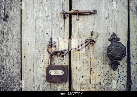 Old wooden door locked - Stock Photo