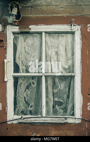 Window with curtain in an old building - Stock Photo