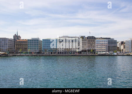 Beautiful view of the historic city center of Geneva with boats on Lake Geneva in the harbor. Blue sky and clouds in summer, Canton of Geneva, Switzerland. - Stock Photo