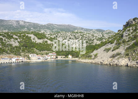 Prizna, Croatia, April 24, 2018. Small village Prizna, ferry port, sea view with Velebit mountain in the background, in the late spring - Stock Photo