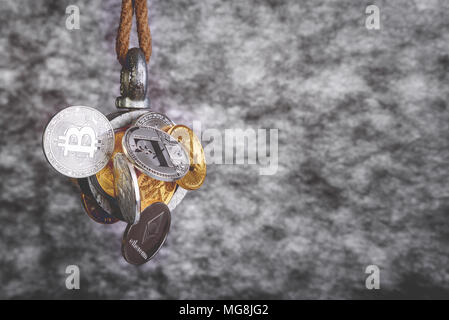 Group of silver and gold crypto currency coins are caught by magnet, business concept, isolated on white background, bitcoin ethereum litecoin coins - Stock Photo