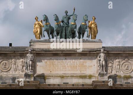 Statues on top of the Arc de Triomphe du Carrousel, Musée du Louvre, Paris - Stock Photo