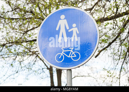 road sign for pedestrians and cyclists - Stock Photo