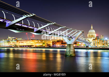 St Paul's Cathedral during night from the Millennium bridge over river Thames, London, United Kingdom. - Stock Photo