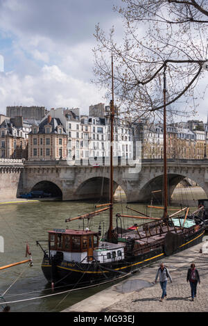 Sailing barges moored by the Pont Neuf, Paris, France - Stock Photo