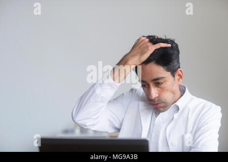 Stressed doctor. - Stock Photo