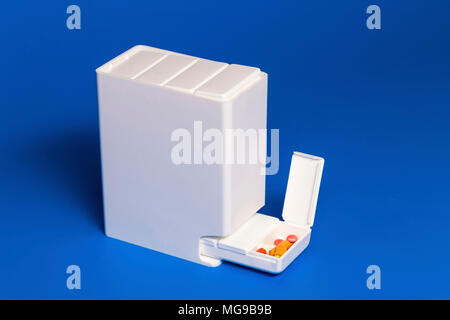 Dispenser with tablets. - Stock Photo