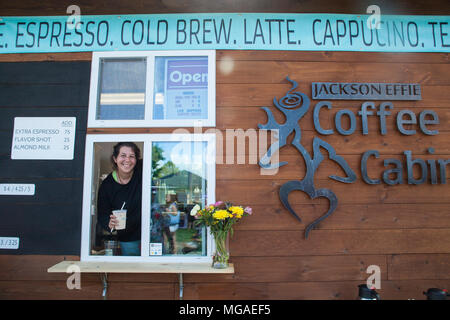 Portrait of a female owner of coffee vending food truck small businessat a food festival - Stock Photo