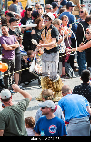 A man on stilts juggles pins while walking along the parade route of the Little Five Points Halloween Parade on October 15, 2016 in Atlanta, GA. - Stock Photo