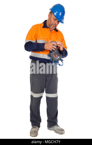 A man checking his gas mask for seal and integrity before commencing work. Safety concept. - Stock Photo