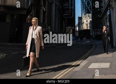Two businesswomen walking along street, City of London, London, England - Stock Photo