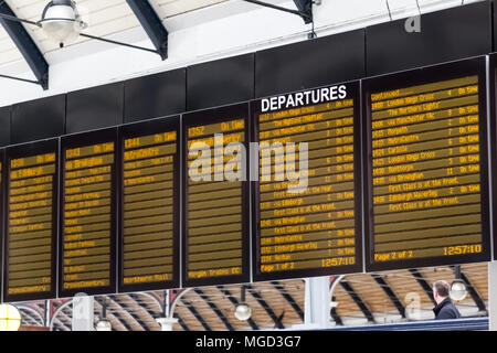 Newcastle/United Kingdom - May 25, 2015: The Departure Information board over the track in Newcastle Central Railway Station in England. - Stock Photo