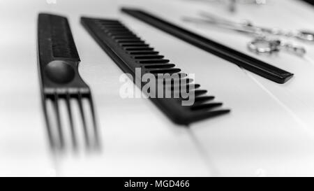 Professional haircut combs, scissors, clips, bowl, coloring brushes for hairstyle salon - Stock Photo