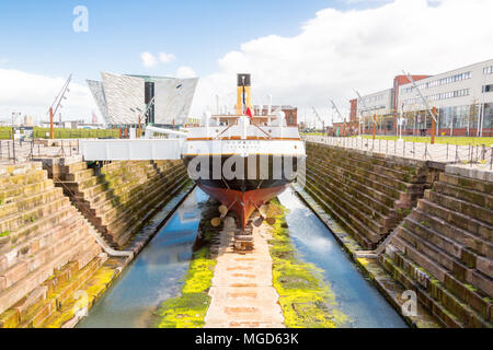 Belfast/N. Ireland - May 31, 2015: In dry dock, being worked on is The Nomadic, based in Cherbourg, France. Here on a sunny day in Belfast. - Stock Photo