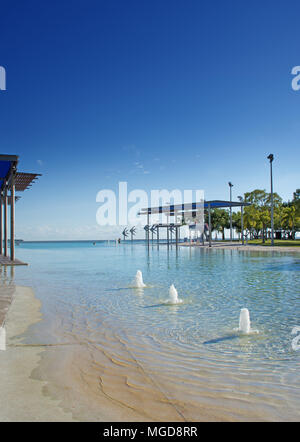 Cairns Esplanade public swimming lagoon on the edge of the Great Barrier Reef in Queensland Australia - Stock Photo