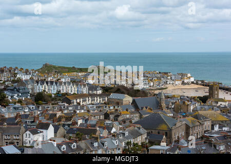 A view over the picturesque Cornish town of st Ives on the co the coast of cornwall. Houses in rows with the sea beyond at saint Ives in cornwall. - Stock Photo