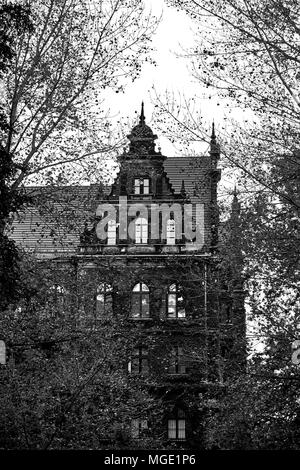 Creepy old house against the blue sky. Black and white. - Stock Photo