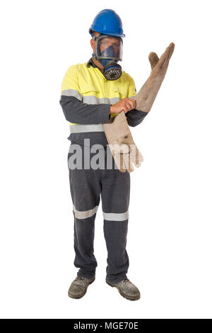 A worker putting on personal protective equipment for working in an hazardous environment. - Stock Photo