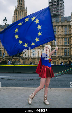 London, UK. 27th April, 2018. Madeleiena Kay, also known as EUsupergirl, waving an EU flag outside Westminster, in support of Remain campaign against  - Stock Photo