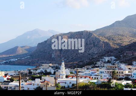 View of Arkasa village at dawn with the mountain headlands in the background on the island of Karpathos in Greece in the Mediterranean Sea - Stock Photo