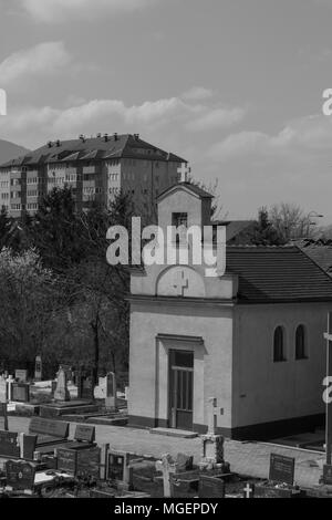Photo of a little church with a graveyard in front of it in black and white. - Stock Photo