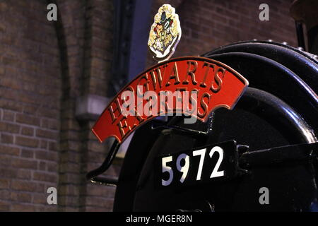 etail of the Hogwarts express locomotive with the red writing and the number of the train departing from platform nine and three quarters
