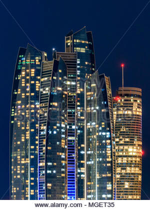 View of Etihad Towers in Abu Dhabi at night. - Stock Photo