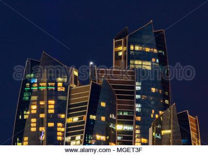View of Etihad Towers in Abu Dhabi at night. - Stock Photo