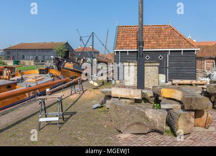 Historical ships anchored near shipyard in harbor Dutch village Workum - Stock Photo