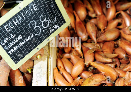 Locally grown shallots for sale ay the Halles St-Louis Market in the centre of Brest, Brittany, France - Stock Photo