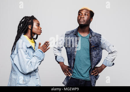 Portrait of an upset young afro american woman please her offended man arms folded isolated over white - Stock Photo