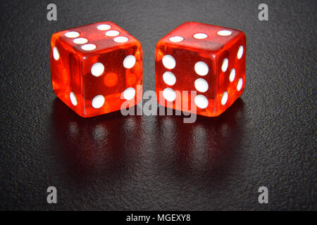 Red luminescent casino gambling dice on black background - Stock Photo