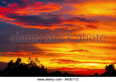 Dramatic lighting in the sky on a rainy day. - Stock Photo