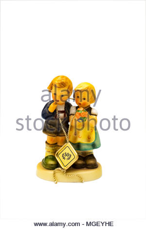 50th anniversary Hummel figurine of boy and girl with bouquet of flowers - Stock Photo