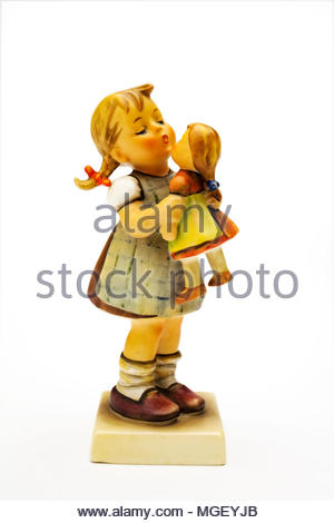 Hummel figurine of girl with doll - Stock Photo