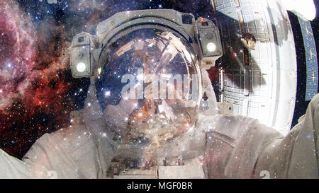 Astronaut in outer space. Science fiction art. Elements of this image furnished by NASA. - Stock Photo