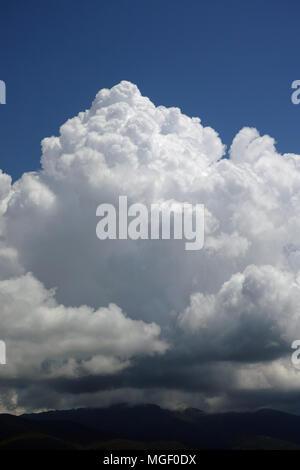towering cumulonimbus cloud, thunderstorm cloud - Stock Photo
