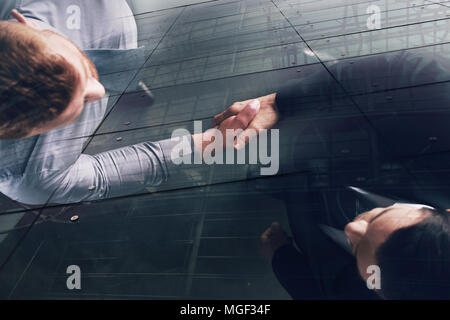 Handshaking business person in office. concept of teamwork and partnership. double exposure - Stock Photo