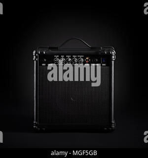 Black bass guitar amplifier on black background - Stock Photo