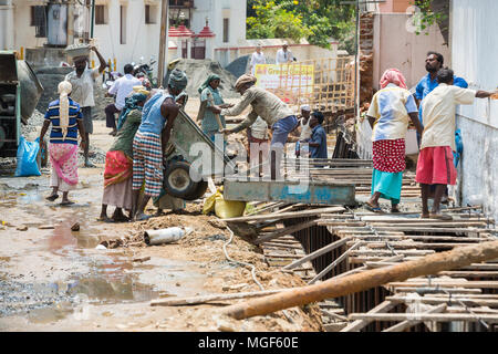 PUDUCHERY, PONDICHERY, TAMIL NADU, INDIA - March circa, 2018. Group of unidentified workers are employed in construction work to build a sidewalk. Ver - Stock Photo