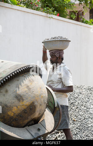 PUDUCHERY, PONDICHERY, TAMIL NADU, INDIA - March circa, 2018. Unidentified workers are employed in construction work to build a sidewalk. Very hard bu - Stock Photo